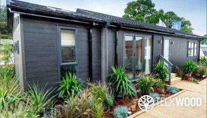 Teckwood's low maintenance composite cladding on a bespoke mobile home