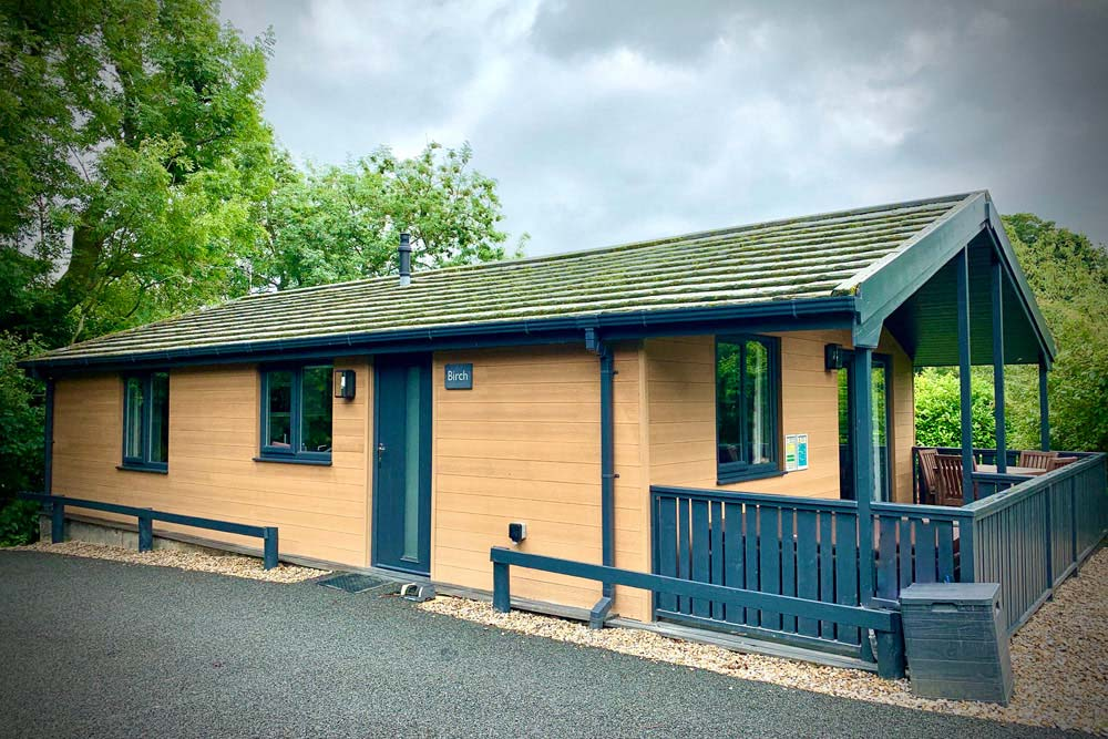 Flowery dell lodges coomposite cladding