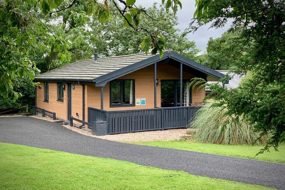 Flowery dell lodges Cladding Teckwood